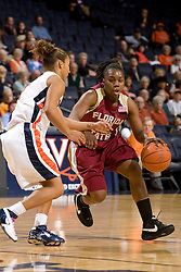 Florida St. guard Shante Williams (22) dribbles past Virginia guard Sharnee Zoll (5).  The Virginia Cavaliers women's basketball team hosted the Florida State Seminoles at the John Paul Jones Arena in Charlottesville, VA on February 10, 2008.