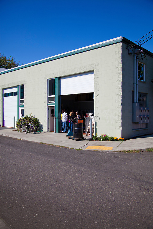 Stone Barn Brandyworks, a micro-distillery in SE Portland, Oregon run by Sebastian and Erica Degens.  They make products that include rye whiskey, pear brandy, and other varieties of distilled spirits and operate out of a very small, green warehouse space.  Their products are not yet for sale other than directly from them.