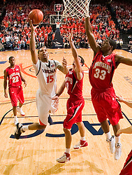 Virginia guard Sylven Landesberg (15) shoots past Maryland guard Greivis Vasquez (21).  The Virginia Cavaliers defeated the Maryland Terrapins 68-63 at the John Paul Jones Arena on the Grounds of the University of Virginia in Charlottesville, VA on March 7, 2009.