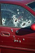 Bullet riddle the side of a car where moments earlier assigns shot dead a former policeman during morning rush hour along a main road in Juarez, Mexico January 16, 2009. The shooting, believed linked to the ongoing drug war which has already claimed more than 40 people since the start of the year. More than 1600 people were killed in Juarez in 2008, making Juarez the most violent city in Mexico.    (Photo by Richard Ellis)