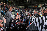 KELOWNA, CANADA - FEBRUARY 1: Referee Bryan Bourdon and linesman Dustin Minty stand at the Calgary Hitmen bench and discuss a game misconduct penalty with head coach Mark French against the Kelowna Rockets on February 1, 2017 at Prospera Place in Kelowna, British Columbia, Canada.  (Photo by Marissa Baecker/Shoot the Breeze)  *** Local Caption ***