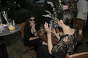 Jo Phillips and Erin O'Connor, Stephen Jones Summer Hat party to celebrate 25 years of Milllinery. Debenham House, 8 Addison Rd. Holland Park, London. 13 July 2006.  ONE TIME USE ONLY - DO NOT ARCHIVE  © Copyright Photograph by Dafydd Jones 66 Stockwell Park Rd. London SW9 0DA Tel 020 7733 0108 www.dafjones.com