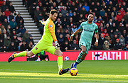 Pierre-Emerick Aubameyang (14) of Arsenal puts pressure on Asmir Begovic (27) of AFC Bournemouth to clear the ball during the Premier League match between Bournemouth and Arsenal at the Vitality Stadium, Bournemouth, England on 25 November 2018.