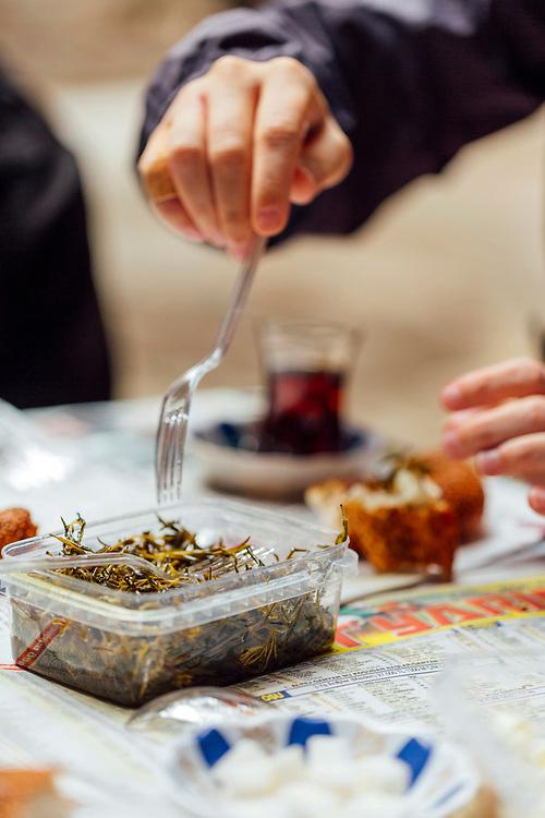 Turkish breakfast snack including simit, Turkish tea, rock samphire and curd cheese, Istanbul, Turkey, 2015–11-14.