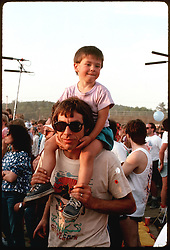 Son riding his Dad's shoulders for a better view of The Grateful Dead Concert at Oxford Plains Speedway, Oxford Maine July 3, 1988