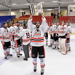 FORT FRANCES, ON - May 2, 2015 : Central Canadian Junior &quot;A&quot; Championship, game action between the Fort Frances Lakers and the Soo Thunderbirds, Championship game of the Dudley Hewitt Cup. Matt Caruso #28 of the Soo Thunderbirds raises the Dudley Hewitt Cup.<br /> (Photo by Shawn Muir / OJHL Images)