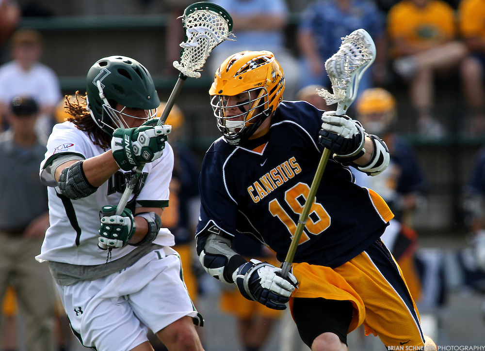 May 12, 2012; Baltimore, MD, USA; Canisius College Golden Griffins midfielder Brandon Bull (18) against Loyola Maryland Greyhounds midfielder Josh Hawkins (5) at Ridley Athletic Complex in Baltimore, MD. Mandatory Credit: Brian Schneider-www.ebrianschneider.com
