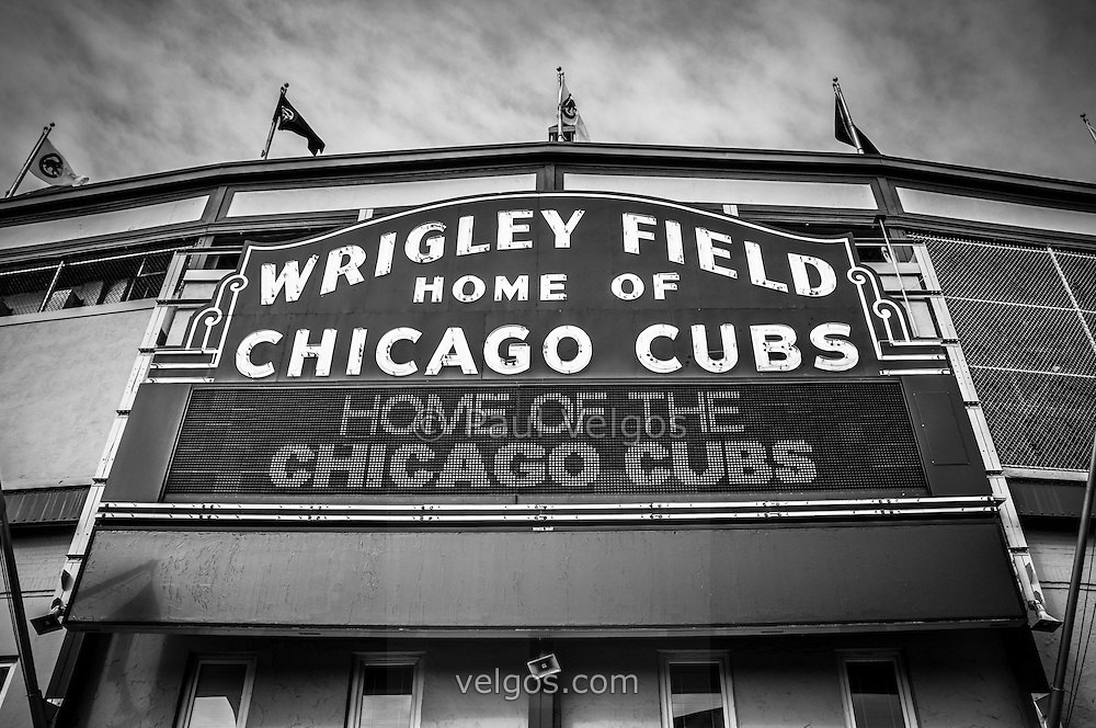 Wrigley Field sign in black and white. Wrigley Field is home of the Chicago Cubs and was built in 1914 making it one of the oldest baseball stadiums in the United States.