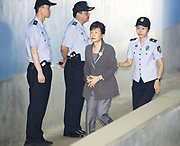 Former South Korean President Park Geun-hye (C) arrives at the Seoul Central District Court from a prison before her trial in Seoul, South Korea, August 4, 2017. Park stood accused of bribery, abuse of power and leaks of government secrets. Park was impeached by the Constitutional Court on March 10, 2017. Photo by Lee Jae-Won (SOUTH KOREA) www.leejaewonpix.com