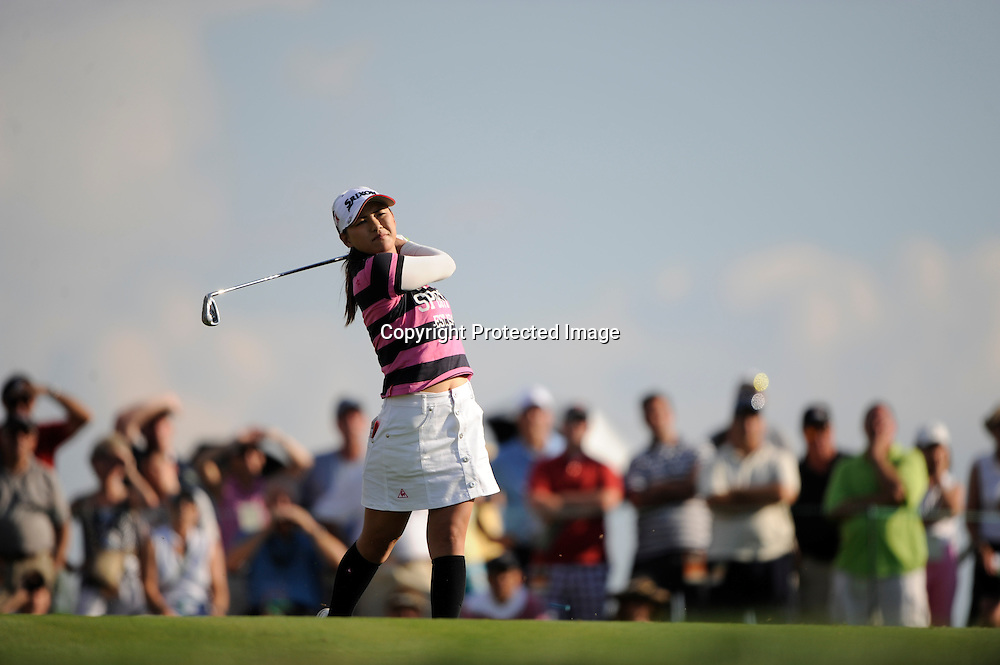 The gallery looks on as Ai Miyazato plays a shot during the third round of the Women's U.S. Open Golf Championship in Oakmont, Pennsylvania.