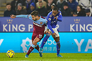 West Ham United midfielder Manuel Lanzini (10) tussles with Leicester City defender Ricardo Pereira (21) during the Premier League match between Leicester City and West Ham United at the King Power Stadium, Leicester, England on 22 January 2020.