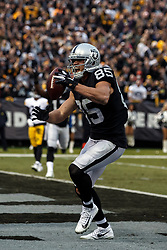 OAKLAND, CA - DECEMBER 09: Tight end Derek Carrier #85 of the Oakland Raiders celebrates after scoring a touchdown against the Pittsburgh Steelers during the fourth quarter at the Oakland Coliseum on December 9, 2018 in Oakland, California. The Oakland Raiders defeated the Pittsburgh Steelers 24-21. (Photo by Jason O. Watson/Getty Images) *** Local Caption *** Derek Carrier