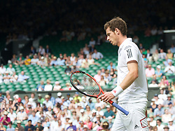 LONDON, ENGLAND - Wednesday, June 30, 2010: Andy Murray (GBR) walks past empty seats on Centre Court during the Gentlemen's Singles Quarter-Final on day nine of the Wimbledon Lawn Tennis Championships at the All England Lawn Tennis and Croquet Club. (Pic by David Rawcliffe/Propaganda)