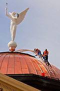 06 FEBRUARY 2012 - PHOENIX, AZ:    Workers repair the historic copper dome on the roof of the old Arizona Capitol building, now the Arizona Capitol Museum. The dome, which has always been copper to mark the state's historic copper mines, was replaced ahead of the state's centennial celebration, which is Feb. 14, 2012. Arizona became the 48th state of the United States on Feb. 14, 1912.    PHOTO BY JACK KURTZ