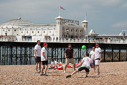 © Licensed to London News Pictures. 31/05/2014. Brighton, UK. A group of men enjoy the early morning sun with some ball games on Brighton Beach. The weekend is expected to reach temperatures of 20C down the South Coast according to the MET office. Photo credit : Hugo Michiels/LNP