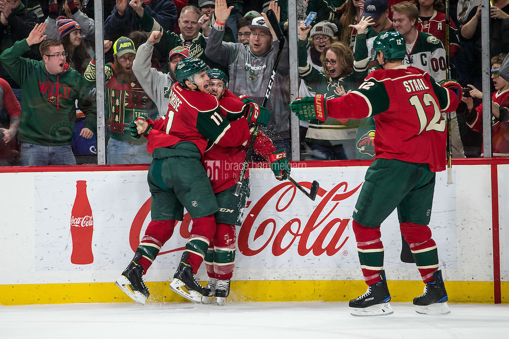 Dec 29, 2016; Saint Paul, MN, USA; Minnesota Wild forward Jordan Schroeder (10) celebrates his goal with forward Zach Parise (11) against the New York Islanders at Xcel Energy Center. The Wild defeated the Islanders 6-4. Mandatory Credit: Brace Hemmelgarn-USA TODAY Sports