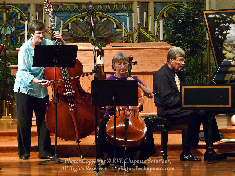 Valley Vivaldi players Nancy Merriam, bass, Deborah Davis, cello, and Allan Birney, harpsichord, perform in a Sunday evening concert starting at 7:30 PM on July 19, 2009 at Wesley Church in Bethlehem, Pennsylvania, USA.