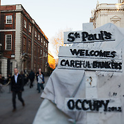 A sign saying; St Paul's welcomes careful bankers. Occupy 2012. The camp Occupy London Stock Exchange outside St Paul's Cathedral was in the morning served with eviction notice after months of legal battle with the Corporation of London. The site was occupied Oct 15th.
