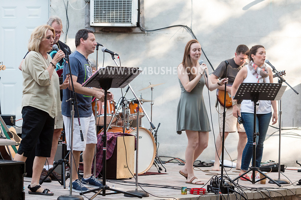 "Middletown, New York - The band ""Side by Side"" performs on the stage during the Middletown Summer Concert Series in Run 4 Downtown Park on June 22, 2017."