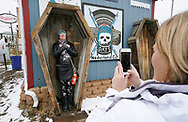 NEDERLAND, CO - MARCH 10: Nicole Elliott poses as dead in a mock coffin at the Frozen Dead Guys Festival on March 10, 2018 in Nederland, Colorado. The Frozen Dead Guy Days festival is in honor of Bredo Morstol, who is frozen on dry ice and housed in a shed above the town. (Photo by Rick T. Wilking/Getty Images)