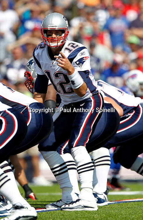 New England Patriots quarterback Tom Brady (12) calls signals during the NFL week 3 football game against the Buffalo Bills on Sunday, September 25, 2011 in Orchard Park, New York. The Bills won the game 34-31. ©Paul Anthony Spinelli