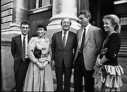 Sean Kelly Welcomed At Government Buildings. (R79).1988..19.05.1988..05.19.1988..19th May 1988..After his win in the Vuelta a España (Tour of Spain) cycle race, Sean Kelly was welcomed back to Dublin by An Taoiseach, Charles Haughey TD. He was greeted and congratulated at Government Buildings, Leinster House, Dublin...Image shows (from left) Martin Earley (who also competed in the Vuelta), Catherine Earley, An Taoiseach, Charles Haughey TD, Sean Kelly and Linda Kelly being greeted on the steps of Government Buildings.