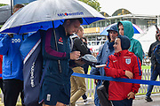 Jos Buttler of England shelters from the rain under an umbrella as he signs his autograph for a young fan ahead of the International Test Match 2019 match between England and Australia at Lord's Cricket Ground, St John's Wood, United Kingdom on 14 August 2019.