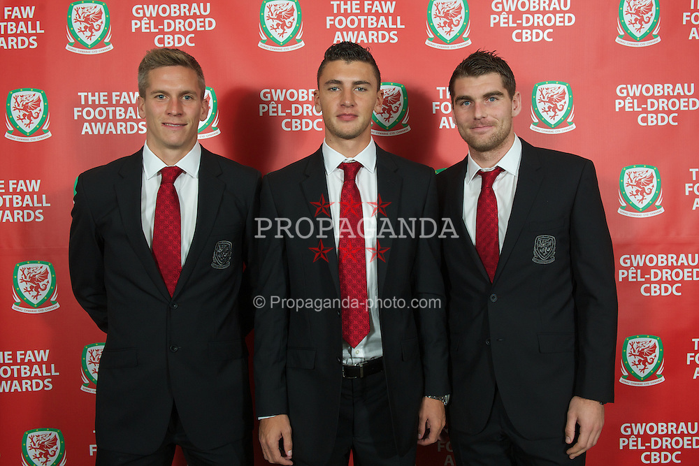 CARDIFF, WALES - Monday, October 8, 2012: Wales' Steve Morison, James Wilson and Sam Vokes during the FAW Player of the Year Awards Dinner at the National Museum Cardiff. (Pic by David Rawcliffe/Propaganda)