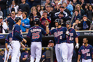 Pedro Florimon #25 of the Minnesota Twins is congratulated by Brian Dozier #2 after hitting a 2-run home run against the Boston Red Sox on May 17, 2013 at Target Field in Minneapolis, Minnesota.  The Red Sox defeated the Twins 3 to 2.  Photo: Ben Krause