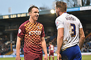 Bradford City Defender, Anthony McMahon and Bury Defender, Chris Hussey have a disagreement after a tackle during the The FA Cup third round match between Bury and Bradford City at Gigg Lane, Bury, England on 9 January 2016. Photo by Mark Pollitt.