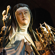 Dating back to 1680, La Iglesia de la Merced stands in the heart of Casco Viejo, the historic old town of Panama City. Its interior is lavishly decorated with statues and religious art. María de Cervelló was a 13th century Spanish saint. She is often depicted with ships after her legend of being seen after her death on the wings of the wind to protect ships against raging winds.