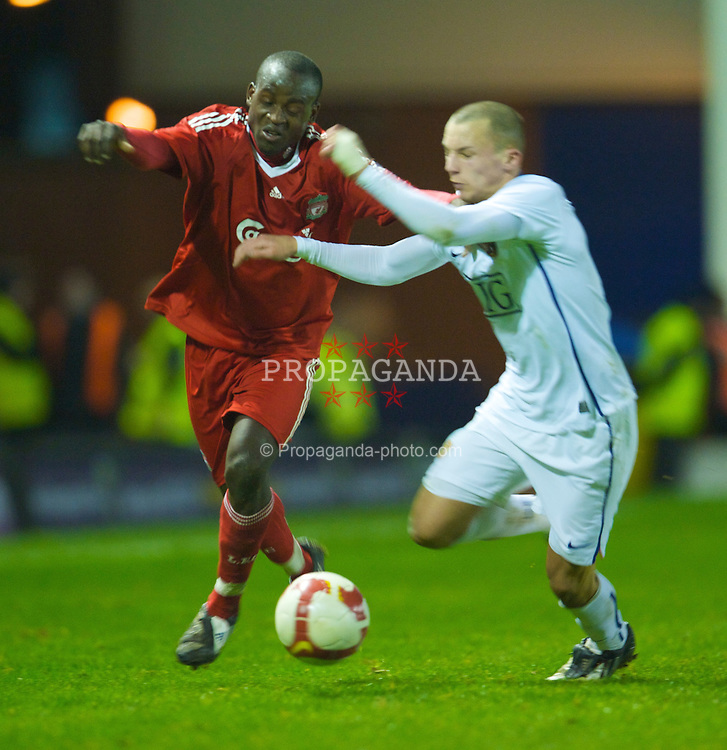 WARRINGTON, ENGLAND - Thursday, March 12, 2009: Liverpool's Emmanuel Gomis Mendy and Manchester United's Daniel Drinkwater during the FA Premiership Reserves League (Northern Division) match at the Halliwell Jones Stadium. (Photo by David Rawcliffe/Propaganda)