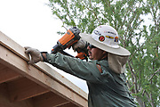 Installing trim that will go below the carport roof's drip edge.