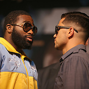 Boxer Adrien Broner (left) faces off against opponent Carlos Molina during the undercard final press conference for the Mayweather & Maidana boxing match at the Hollywood Theater, inside the MGM Grand hotel on Thursday, May 1, 2014 in Las Vegas, Nevada.  (AP Photo/Alex Menendez)