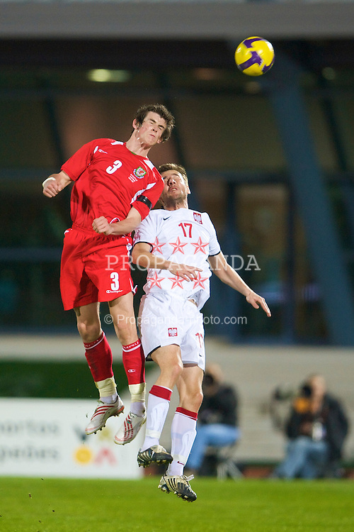 VILA REAL DE SANTO ANTONIO, PORTUGAL - Wednesday, February 11, 2009: Wales' Gareth Bale in action against Poland's Wojciech Lobodzinski during the International Friendly match at the Vila Real de Santo Antonio Sports Complex. (Mandatory credit: David Rawcliffe/Propaganda)