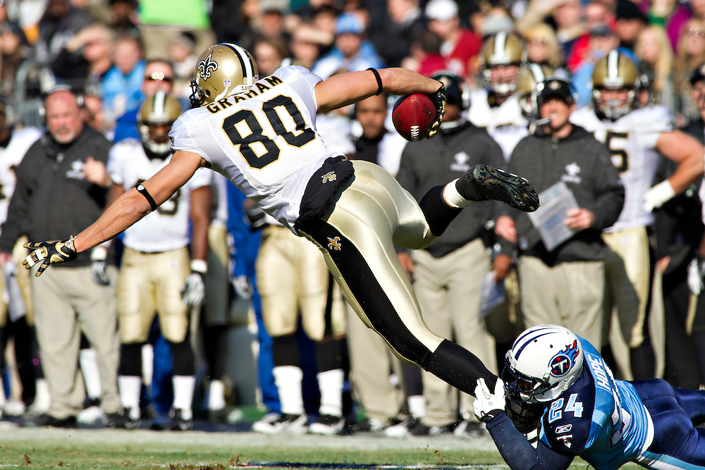 NASHVILLE, TN - DECEMBER 11:   Jimmy Graham #80 of the New Orleans Saints is tackled by Chris Hope #24 of the Tennessee Titans at LP Field on December 11, 2011 in Nashville, Tennessee.  The Saints defeated the Titans 22-17.  (Photo by Wesley Hitt/Getty Images) *** Local Caption *** Jimmy Graham; Chris Hope