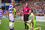 Queens Park Rangers forward Sebastian Polter (17) told to calm down  by referee Mr S Martin during the EFL Sky Bet Championship match between Queens Park Rangers and Reading at the Loftus Road Stadium, London, England on 15 October 2016. Photo by Jon Bromley.