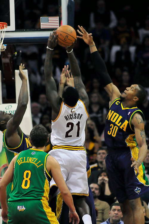 March 6, 2011; Cleveland, OH, USA; Cleveland Cavaliers power forward J.J. Hickson (21) shoots over New Orleans Hornets power forward David West (30) during the second quarter at Quicken Loans Arena. Mandatory Credit: Jason Miller-US PRESSWIRE