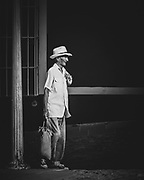 Old man in the streets of the Spanish colonial town of Trinidad in the south of Cuba. Whilst a dramatically colourful city, I found the simplicity of black & white creates more atmosphere.