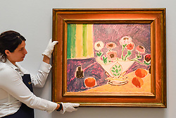 "© Licensed to London News Pictures. 14/06/2019. LONDON, UK. A technician presents ""Vase d'anémones"". 1946, by Henri Matisse (Est. £4-6m). Preview of Impressionist and Modern art sales, which will take place at Sotheby's New Bond Street on 18 and 19 June 2019.  Photo credit: Stephen Chung/LNP"
