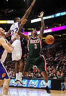Feb. 2, 2011; Phoenix, AZ, USA; Milwaukee Bucks guard Brandon Jennings (3) looses the ball against Phoenix Suns guard Zabian Dowdell (22) at the US Airways Center. Mandatory Credit: Jennifer Stewart-US PRESSWIRE