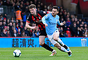 David Silva (21) of Manchester City battles for possession with Chris Mepham (33) of AFC Bournemouth during the Premier League match between Bournemouth and Manchester City at the Vitality Stadium, Bournemouth, England on 2 March 2019.