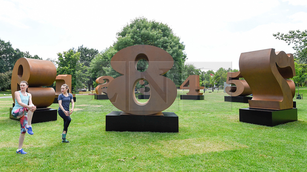 """© Licensed to London News Pictures. 03/07/2019. LONDON, UK. """"ONE Through ZERO"""", 1980-2002, by Robert Indiana. Frieze Sculpture opens in Regent's Park, London's largest free display of outdoor art.  Works from 23 international artists are on display 3 July to 6 October 2019.  Photo credit: Stephen Chung/LNP"""