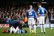 Queens Park Rangers midfielder Junior Hoilett receives treatment early on in the first half during the Sky Bet Championship match between Queens Park Rangers and Ipswich Town at the Loftus Road Stadium, London, England on 6 February 2016. Photo by Andy Walter.