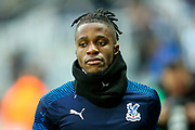Wilfried Zaha (#11) of Crystal Palace warms up ahead of the Premier League match between Newcastle United and Crystal Palace at St. James's Park, Newcastle, England on 21 December 2019.