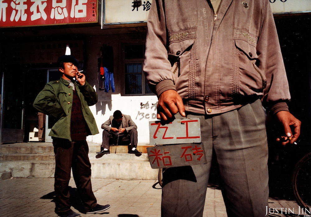 Tieling city, Liaoning Province, China, 11-2003..Laid-off factory workers in China's northeastern rustbelt look for work. Millions of workers are made unemployed as China restructures its economy, slashing the bloated state-sector economy and closing factories...Tieling is home to huge numbers of illegal Chinese immigrants in Europe.