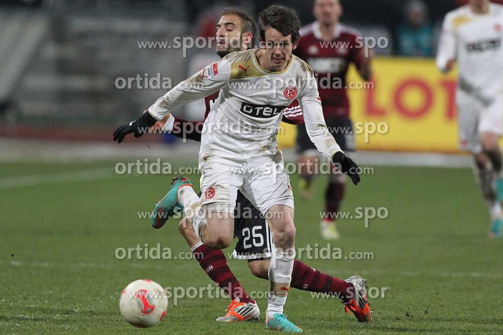 08.12.2012, easyCredit Stadion, Nuernberg, GER, 1. FBL, 1. FC Nuernberg vs Fortuna Duesseldorf, 16. Runde, im Bild Robbie KRUSE (Fortuna Duesseldorf) laeuft Javier PINOLA (1. FC Nuernberg) davon // during the German Bundesliga 16h round match between 1. FC Nuernberg and Fortuna Duesseldorf at the easyCredit Stadium, Nuernberg, Germany on 2012/12/08. EXPA Pictures © 2012, PhotoCredit: EXPA/ Eibner/ Wuest..***** ATTENTION - OUT OF GER *****