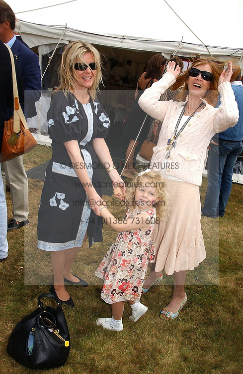 """Left to right, LADY LINLEY, her daughter the HON.MARGARITA ARMSTRONG-JONES and LADY STEWART wife of Jackie Stewart at the Goodwood Festival of Speed on 9th July 2006.  Cartier sponsored the """"Style Et Luxe' for vintage cars on the final day of this annual event at Goodwood House, West Sussex and hosted a lunch.<br /><br />NON EXCLUSIVE - WORLD RIGHTS"""