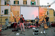 Roma 16  Settembre 2011.Quartiere San Lorenzo.Concerto a pedali dei Tetes de Bois con il progetto «Riciclisti», un palco totalmente eco-sostenibile, senza neanche un Watt di energia elettrica.Ad alimentare gli strumenti, gli amplificatori, le luci e i video sono le gambe e il sudore di 128 ciclisti in piazza. .Rome September 16, 2011  .San Lorenzo district  .Concert pedal, the Tetes de Bois, with the project 'recycling', a stage totally ecologically sustainable, not even one watt of electricity. For feed  the instruments, amplifiers, lights and video are the legs and the sweat of 128 cyclists in the square.