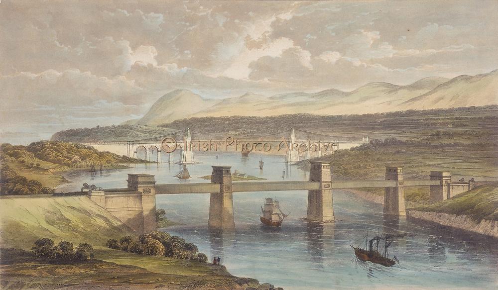 Britannia Tubular Bridge over Menai Straits between Welsh mainland and Angelsea. Chester and Holyhead Railway. Begun 1846, opened 18 March 1850. Engineer Robert Stephenson. Box girder bridge. In the background is Thomas Telford's road suspension bridge built 1820-1826.